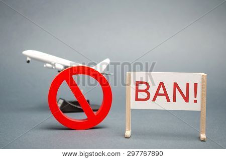 A Poster With The Word Ban. The Sign Of The Ban And A Miniature Toy Aircraft. Ban On Flights Of Civi