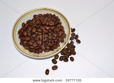 Coffee grains on a saucer