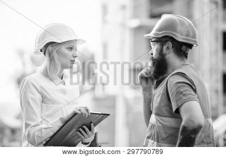 Discuss Progress Project. Construction Project Inspecting. Safety Inspector Concept. Woman Inspector