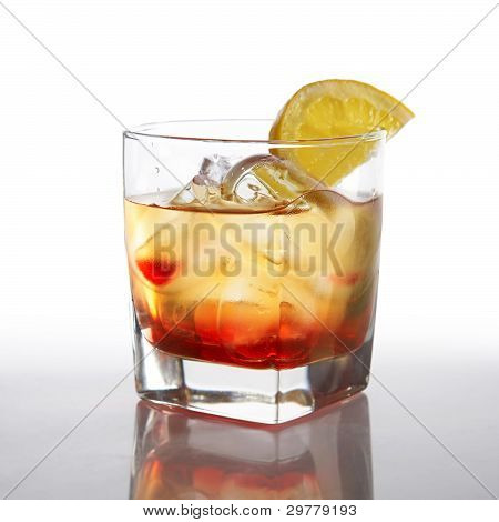 Cocktail With Liquor And Lemon