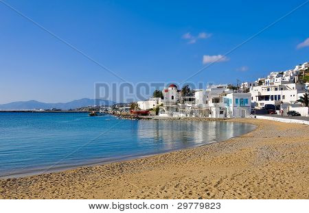 The Famous Tavern On The Bay Of The Island Of Mykonos With A Red Boat And The Church