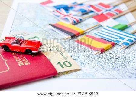 Going To Travel. Passport, Magnifier, Red Toy Car And Money On Map. Save Money On Travel, Planning F
