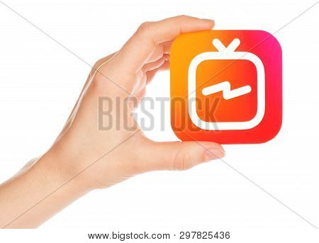 Kiev, Ukraine - February 21, 2019: Hand Holds Instagram Tv Icon Printed On Paper. Igtv Is A Standalo