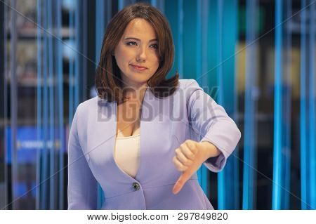 Woman With Pessimistic Emotion In A Television Studio Shows A Gesture Of Fingers To The Bottom