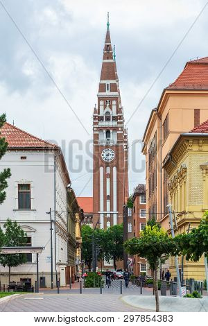 Szeged, Hungary, June 27: Citizens And Visitors Of The City Are Walking Down The Street. In The Back