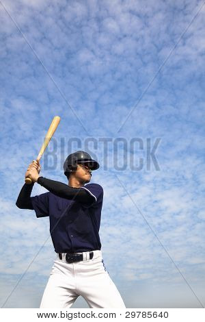 baseball player strike ball in the sky