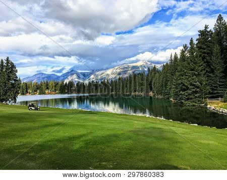 A Beautiful Golf Hole In The Jasper, Alberta, High In The Rockies Mountains.  The Fairway Is Beside