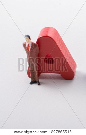 Man figurine and Letters of abc of alphabet on white poster