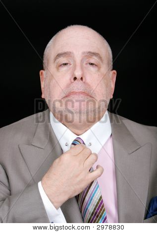 Dapper Businessman Fixing Tie