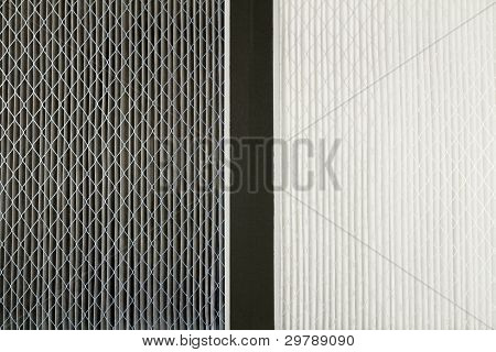 Close up side by side comparison of a dirty gray home air filter next to a clean white house furnace air filter. poster