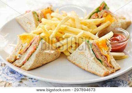 Club Sandwich Or Ham And Egg Sandwich With French Fries