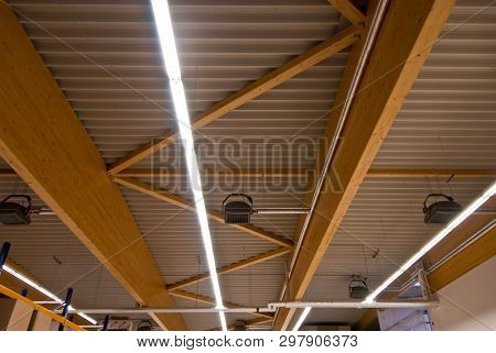 Large Wooden Trusses Support The Roof Of A Large Factory Building