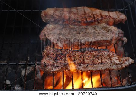 Striplion steaks on the barbecue