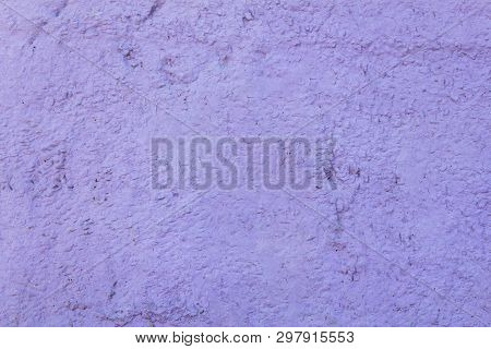 Light Purple Granular Concrete Wall With A Relief. Rough Surface Texture