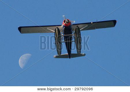 Floatplane Passing The Moon