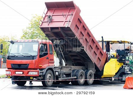 Dumptrack And Asphalt Spreading Machine  Working  On  Road