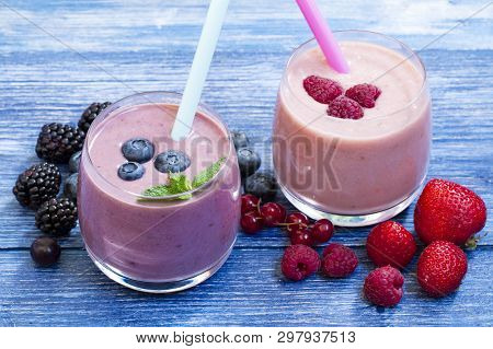 Homemade Smoothie With Fresh Blueberries And Strawberry On Rustic Blue Background. Weight Loss Conce
