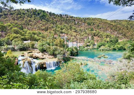 Krka, Sibenik, Croatia, Europe - August 28, 2017 - Tourists Hiking And Bathing At Krka National Park