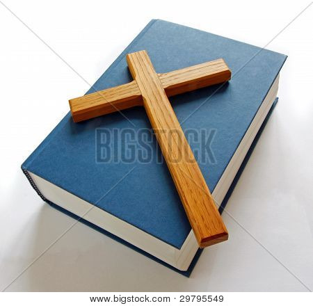 Wooden cross on bible