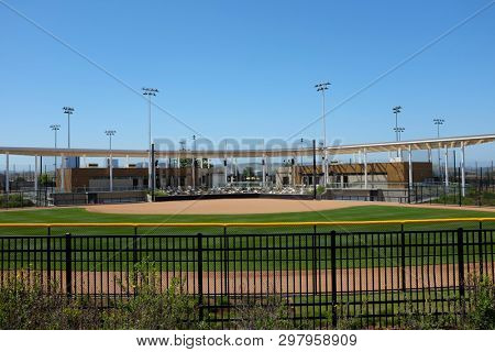 IRVINE, CALIFORNIA - APRIL 25, 2019: The Great Park Softball Stadium seen from beyond the outfield fence. The facility is surrounded by additional fields.