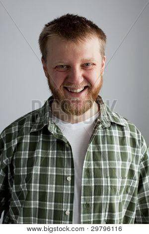 Young Man In A Plaid Shirt