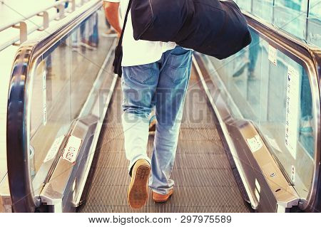 Men At Horizontal Escalator Covered. Moving Walkway, Moving Sidewalk, Moving Pavement, Autopedescala