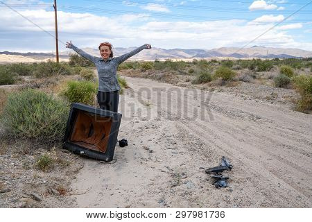Woman Poses With An Old Busted Broken Crt Television In The Middle Of The Desert, Near The Salton Se