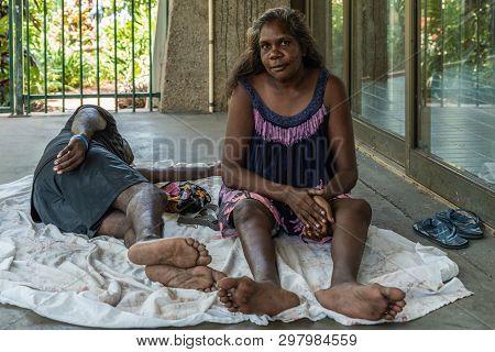 Darwin Australia - February 22, 2019: Closeup Of Young Aboriginal Woman Sitting On Her Behind In Sha