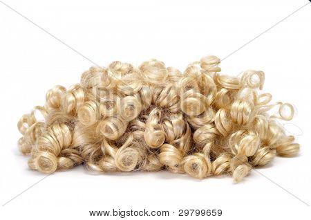 closeup of a curly blonde wig