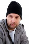 Portrait of male homeless beggar over white background poster