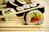 Traditional japanese food. Sushi on bamboo napkin poster