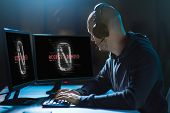 cybercrime, hacking and technology concept - male hacker in headset with access denied messages on computer's screens wiretapping or using computer virus program for cyber attack in dark room poster