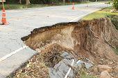 Broken and damage asphalt road by landslide poster
