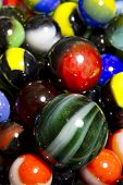 A collection of colorful round glass marbles. poster