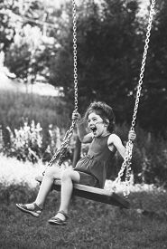 Black And White Portrait Of Beautiful Little Girl Smiling On Swing At Summer Day, Happy Childhood Co