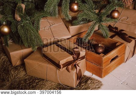 Beautiful Christmas Gifts Under Tree In New Year Decorated House Interior.