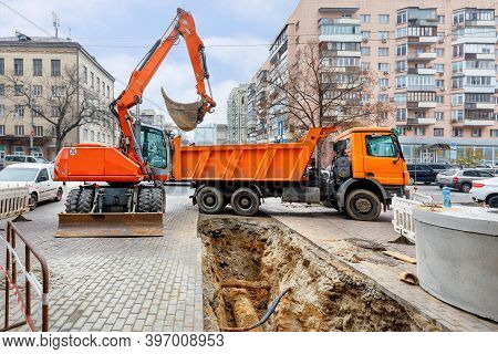 Emergency Road Vehicles, An Excavator And A Truck Are Working On The Repair Of The Heating Main. A D