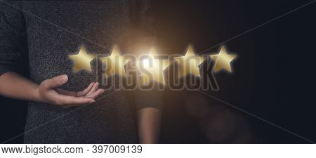 The Concept Of Assessment. Hand Pointing To Five Stars To Increase The Company's Rating, Increase Th