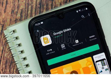 Google Slides Dev App With Magnifying On Smartphone Screen. Google Slides Is A Freeware Web Browser