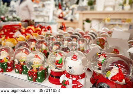 Glass Christmas Toys, Souvenirs - Snowballs On The Counter. Snow Globes With Christmas Or Winter The