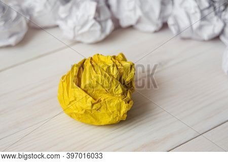 Set Of Crumpled Paper Balls With One Yellow