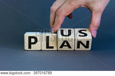 Plus Plan. Male Hand Turns Wooden Cubes With Words 'plus Plan'. Beautiful Grey Background, Copy Spac