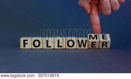 Follow Me. Male Hand Turns Wooden Cubes And Changes The Words 'follower' To 'follow Me'. Beautiful G
