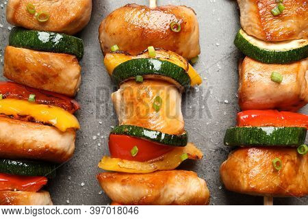 Delicious Chicken Shish Kebabs With Vegetables And Salt On Grey Table, Flat Lay