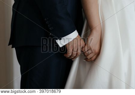 Bride Holding His Fiance Hand. Closeup Couple Hands. Couple In Love