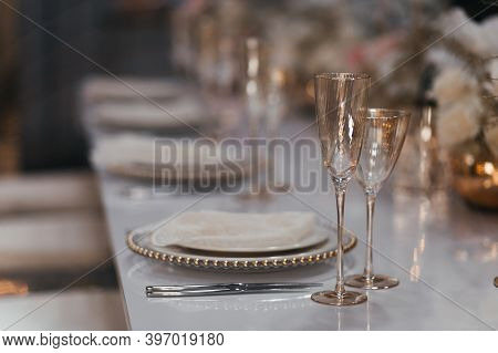 Champagne Glasses On The Table. Luxury Table Set In The Restaurant. Glasses And Plates. Decorations.