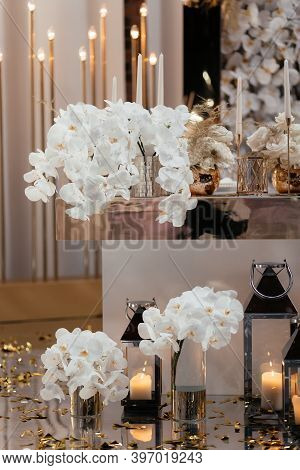 Wedding Reception Place Decorated With White Orchids And Candles. Wedding Restaurant Decorations. We