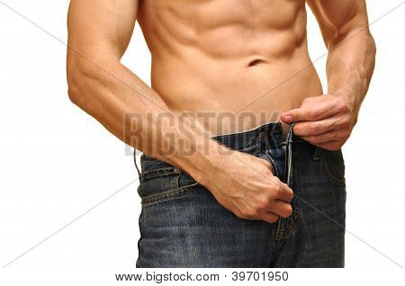 Sexy man with lean abdominals unzips his jeans on white background poster