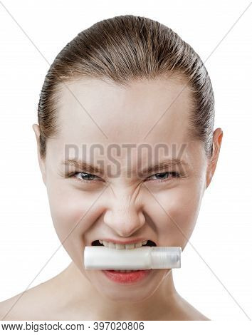 Beautiful Young Woman With Clean Fresh Skin Holds A Tube Of Cosmetic Product In Your Teeth. Predator