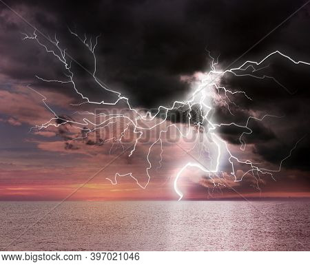 Dark Cloudy Sky With Lightning Striking Sea. Picturesque Thunderstorm